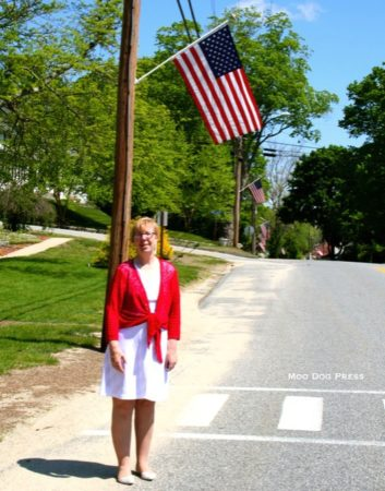 Senator and First Selectman Cathy Osten in Sprague at the foot of Salt Rock Road with some of the flags.