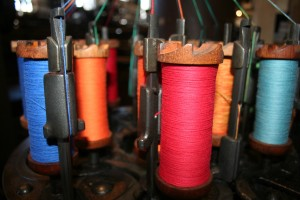 Color spooled inside the mill. Stories of textiles and business.