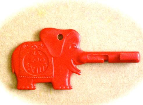 A red Trunkey elephant shaped key.