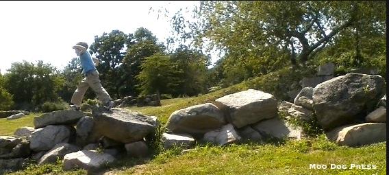 Child on rocks outside.